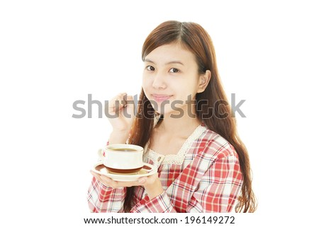 Portrait of woman drinking coffee on white background. - stock photo