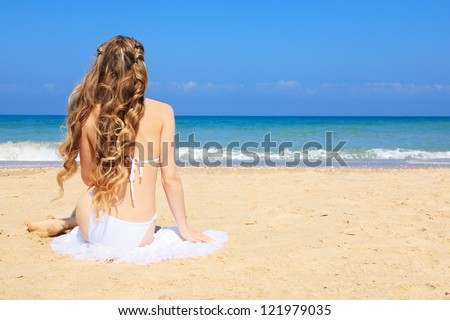 Portrait of woman enjoys in sunny day relaxing and sunbathing on the coast.