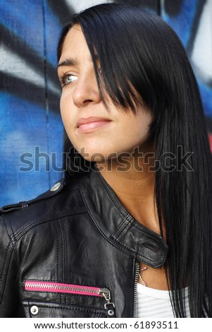 portrait of woman graffiti background. More images of this models you can find in my portfolio - stock photo