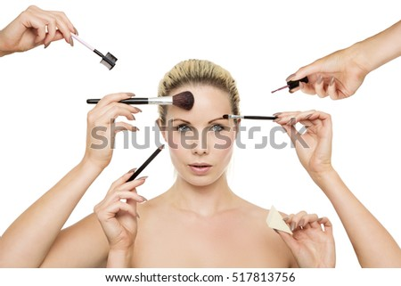 Portrait of woman have make up put on with hands all around her