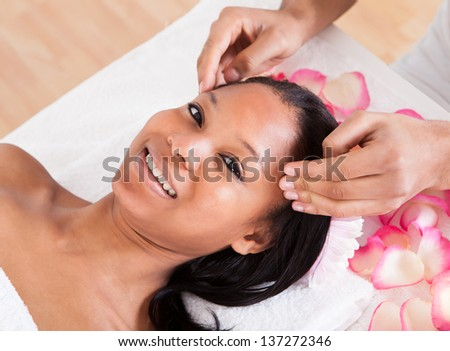 Portrait Of Woman Having A Massage In Spa - stock photo