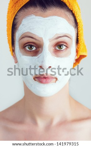 Portrait of woman having a sake and rice smoothing face mask