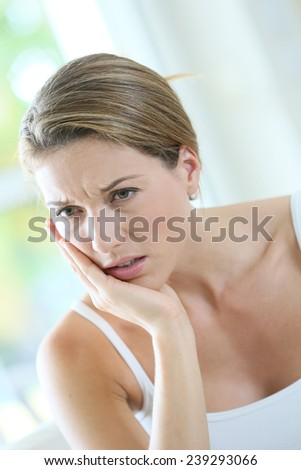Portrait of woman having bad toothache - stock photo