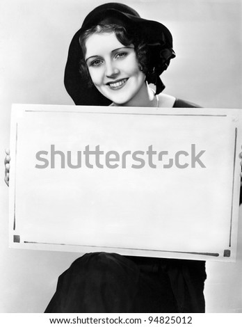 Portrait of woman holding sign in Hungarian - stock photo