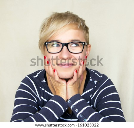 portrait of woman in black glasses dreaming