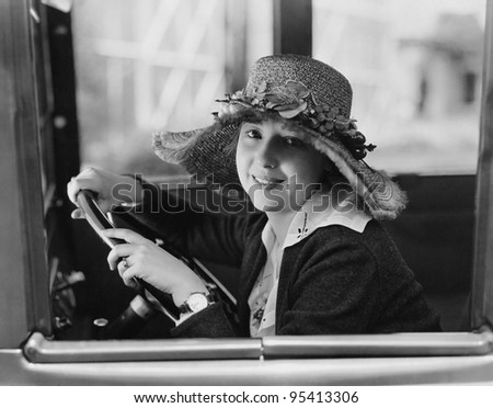 Portrait of woman in drivers seat - stock photo