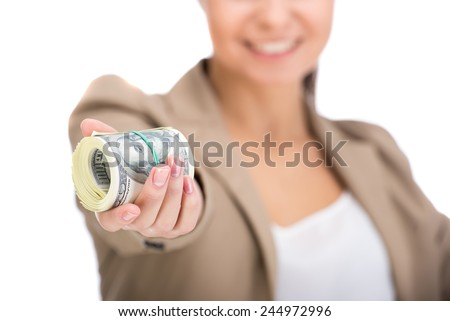 Portrait of woman is holding in hand a lot american dollars, isolated on white background.