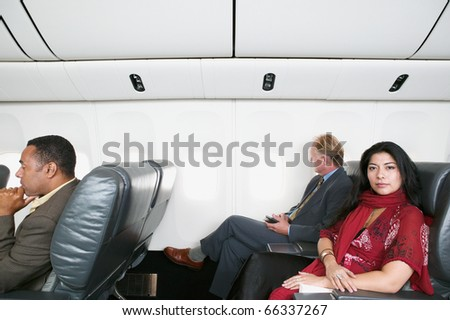 Portrait of woman on airplane - stock photo