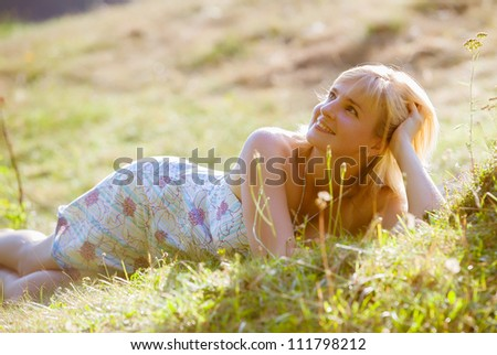 Portrait of woman on park - stock photo