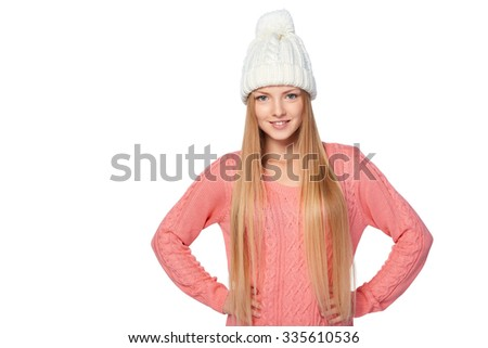 Portrait of woman on white background wearing woolen hat and sweater - stock photo
