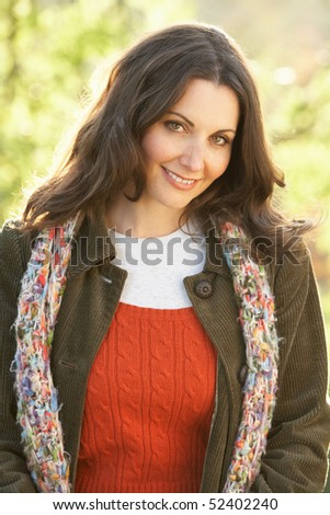 Portrait Of Woman Outdoors In Autumn Landscape - stock photo