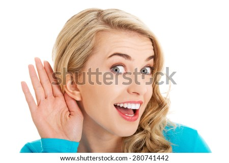 Portrait of woman overhearing a conversation. - stock photo