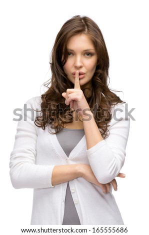 Portrait of woman silence gesturing, isolated on white. Concept of secret and mystery - stock photo