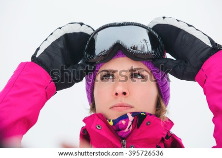 Portrait of woman snowboarder - stock photo