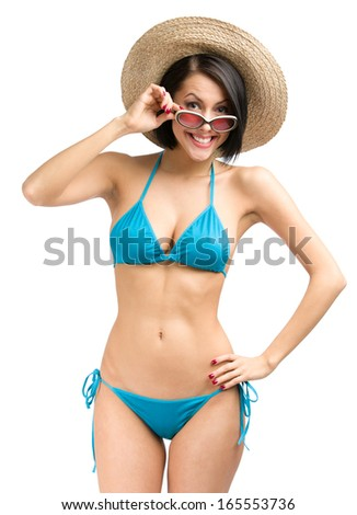 Portrait of woman wearing bikini, hat and sunglasses, isolated on white. Concept of summer holidays and traveling - stock photo