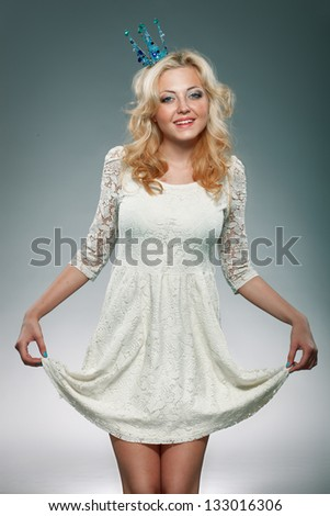 portrait of woman wearing  blue princess crown - stock photo