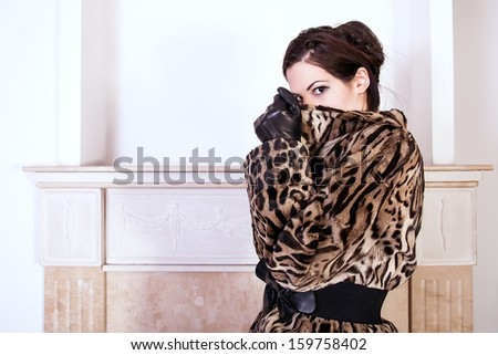 portrait of woman wearing fur coat