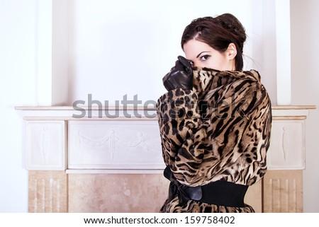 portrait of woman wearing fur coat - stock photo