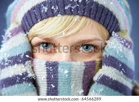 PORTRAIT OF WOMAN WEARING TURTLE NECK, WINTER HAT AND SCARF - stock photo