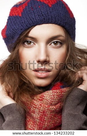Portrait of woman wearing woolen accessories, not isolated on white background - stock photo