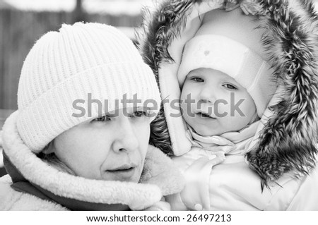 Portrait of woman with a baby outdoor in winter