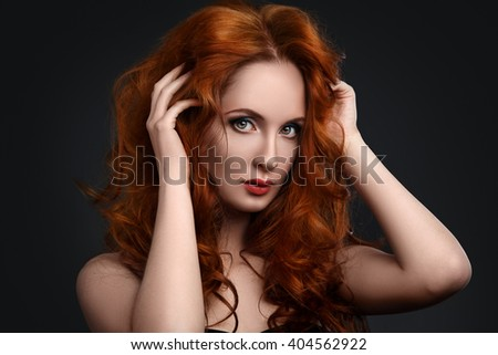 Portrait of woman with beautiful red hair