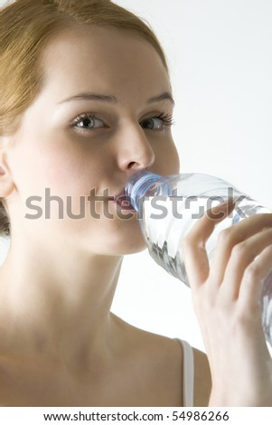 portrait of woman with bottle of  water - stock photo