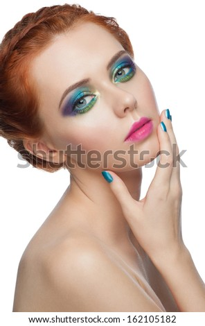 Portrait of woman with colorful  peacock style makeup and turquoise manicure, isolated on white background