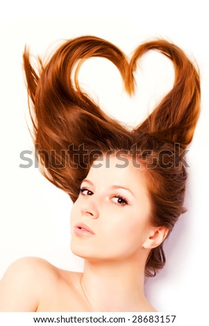 portrait of woman with long hair in shape of heart - stock photo