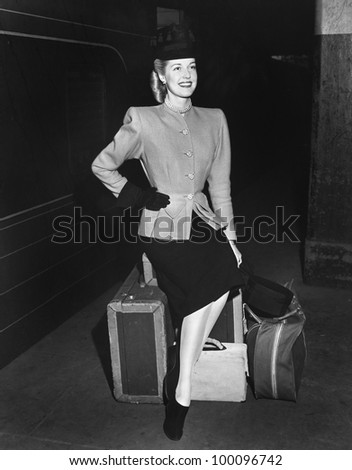 Portrait of woman with luggage