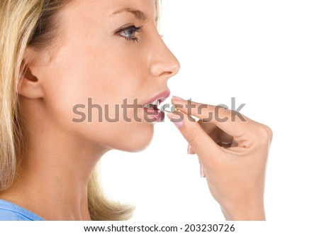 Portrait of woman with Omega 3 fish oil capsule, isolated on white background - stock photo