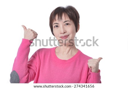 Portrait of woman with thumbs up-white background - stock photo