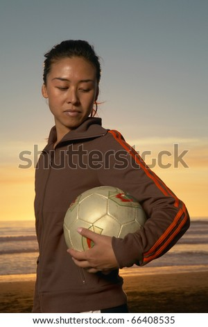 Portrait of woman with volleyball - stock photo