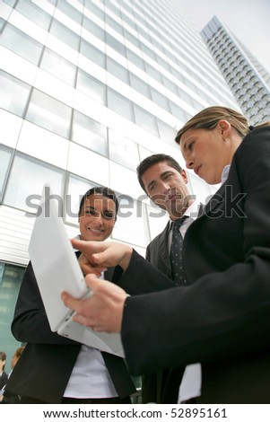 Portrait of women and a man with a laptop computer - stock photo