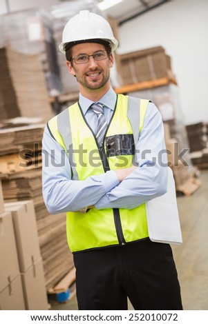 Portrait of worker wearing hard hat in the warehouse - stock photo