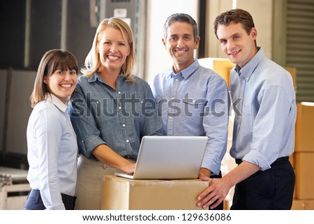 Portrait Of Workers In Distribution Warehouse - stock photo