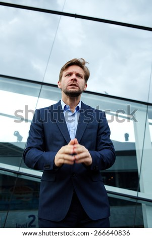 Portrait of worried loser businessman reasoning and explaining something, male office worker try correct the error talking something - stock photo