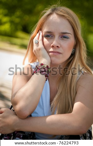 Portrait of worried teenager worried, youth lifestyle concept, head in hand - stock photo
