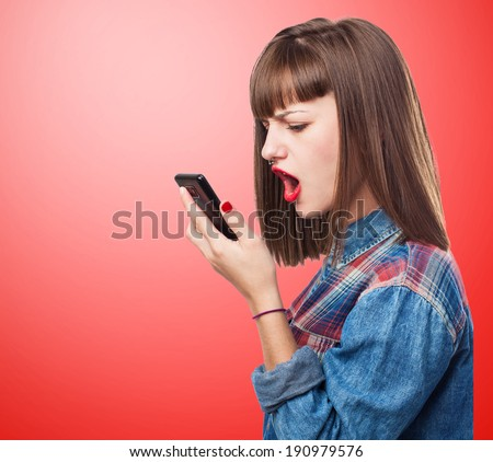 portrait of worried young girl talking on mobile phone - stock photo
