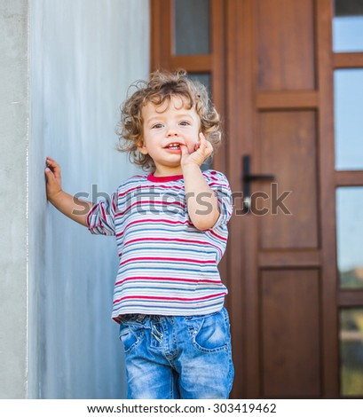 Portrait of 1 year old baby boy sucking his finger. - stock photo