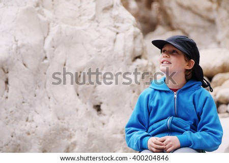 Portrait of 8 years old kid outdoors - stock photo