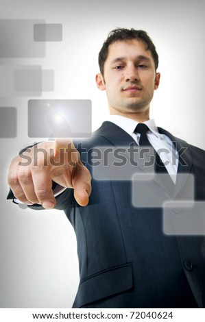 Portrait of Young adult business man pressing a touchscreen button,  focus on finger
