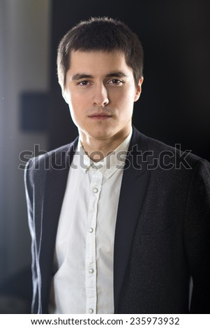 portrait of young adult businessman in suit - stock photo