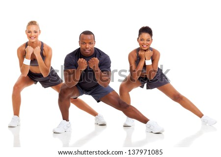portrait of young adult exercising on white background