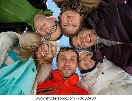 Portrait of young adult friends, view from below - stock photo