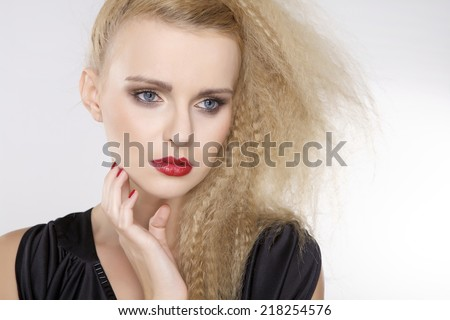 Portrait of young adult  pretty attractive and sensuality beautiful woman with beautiful blond curly hairs and red lips and nails isolated on white background - stock photo