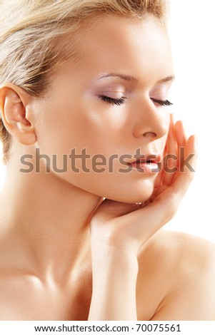 Portrait of young adult woman with health skin of face. Spa theme