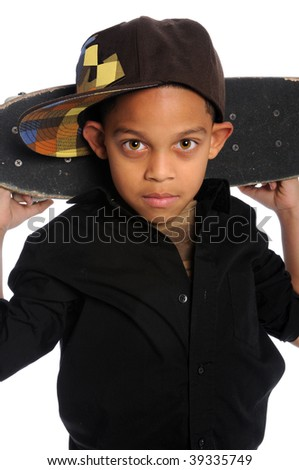 Portrait of young African American boy with skateboard behind head - stock photo