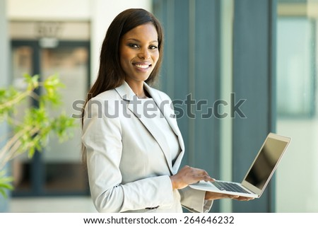 portrait of young african american business woman with laptop - stock photo