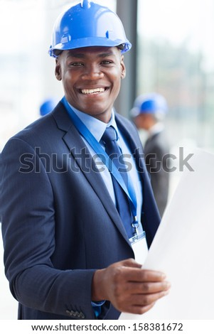 portrait of young african american construction manager - stock photo